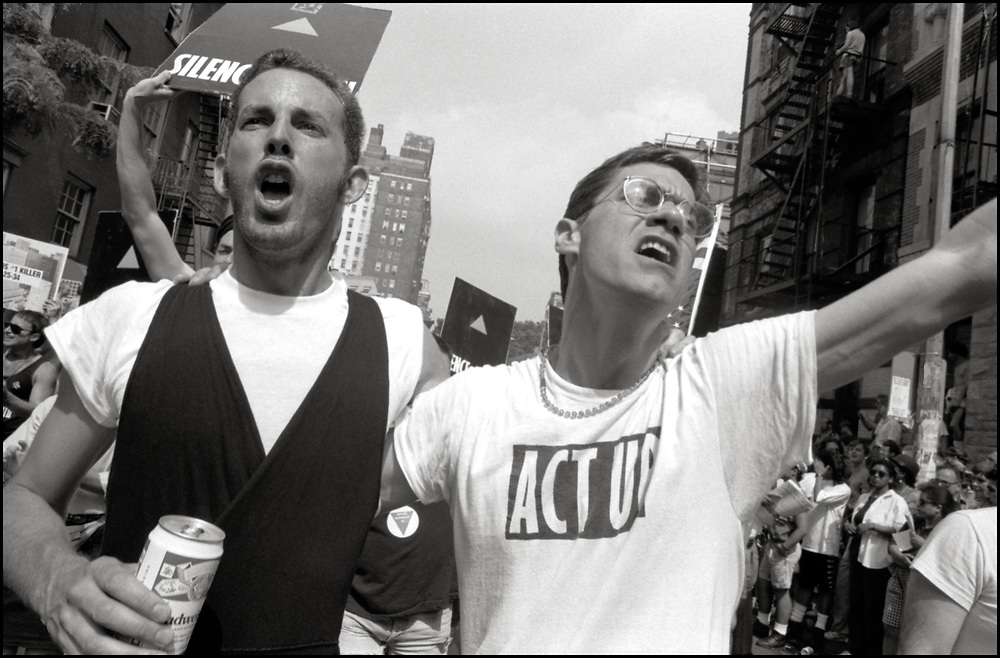 """David Gips and Walter Armstrong of ACT UP NY, on June 24, 1989, the 20th anniversary of the Stonewall riots, participating in a renegade march up 6th avenue to Central Park. Themed, """"In The Tradition"""", this march followed the same route as the original march 20 years ago and was designed as a rebuke to the corporatization of the gay pride parade."""