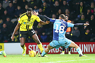 Burton Albion forward Lucas Akins (10) takes on Wycombe Wanderers Curtis Thompson (18) during the EFL Sky Bet League 1 match between Burton Albion and Wycombe Wanderers at the Pirelli Stadium, Burton upon Trent, England on 26 December 2018.