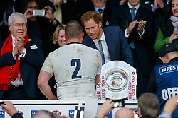 Prince Harry presents the trophy to Dylan Hartley (capt) after England hang on to win the match 25-21 to lift the Triple Crown having beaten Scotland, Ireland and Wales in the 6 Nations - Mandatory byline: Rogan Thomson/JMP - 12/03/2016 - RUGBY UNION - Twickenham Stadium - London, England - England v Wales - RBS 6 Nations 2016.