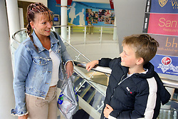 Single mother talking to young son,