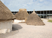 Reconstruction of neolithic homes thatched round houses huts, Stonehenge, Wiltshire, England, UK new visitor centre