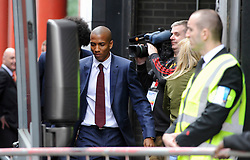 © Licensed to London News Pictures. 21/05/2016. London, UK. Ashley Young boards the bus. Fans and supporters gather outside the Hilton hotel near Wembley Stadium to see the players of Manchester United board the team bus for the short journey to Wembley Stadium ahead of the FA Cup Final against Crystal Palace. Photo credit : Stephen Chung/LNP