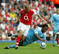 Photo. Chris Ratcliffe. Digitalsport<br /> Arsenal v Bolton Wanderers. Barclays Premiership. 18/09/2004<br /> Fredrik Ljungberg of Arsenal clashes with Ricardo Gardner of Bolton
