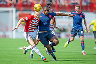 Ziggy Gordon of Hamilton Academical FC and Uche Ikpeazu of Heart of Midlothian tussle for the ball during the Ladbrokes Scottish Premiership League match between Hamilton Academical FC and Heart of Midlothian FC at New Douglas Park, Hamilton, Scotland on 4 August 2018. Picture by Malcolm Mackenzie.