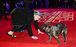 Carrie Fisher and dog Gary attending the Star Wars: The Force Awakens European Premiere held in Leicester Square, London. PRESS ASSOCIATION Photo. See PA story SHOWBIZ StarWars. Picture date: Wednesday December 16, 2015. Photo credit should read: Ian West/PA Wire