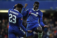 Michy Batshuayi (L) of Chelsea celebrates with Kurt Zouma of Chelsea (R) after Batshuayi scores Chelsea's 4th goal. The Emirates FA Cup 4th round match, Chelsea v Brentford at Stamford Bridge in London on Saturday 28th January 2017.<br /> pic by Steffan Bowen, Andrew Orchard sports photography.