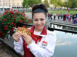 © Licensed to London News Pictures. 28/08/2014; Bristol, UK.  Claudia Fragapane (4 Gold medals in gymnastics at the Commonwealth Games) at the Commonwealth Games) at the Bristol sporting heroes parade for Commonwealth Games 2014 medallists and members of the England Womens Rugby World Cup winners.  The parade started at the Bristol Hawks Gymnastics Club in Easton, where 4 times Gold medal winner Claudia Fragapane trains, and went to Bristol CIty Hall.  Five of the eight Glasgow Commonwealth Games medallists have a Bristol connection:  Claudia Fragapane (4 Golds in gymnastics), David Luckman (Gold in shooting), Jazmin Sawyers (Silver in Long Jump), Gary Hall (Bronze in Judo), and Paul Brown (Bronze in para-lawn bowls).  Members of the England Womens Rugby World Cup team present were Amber Reed, Kay Wilson, Sophie Hemming, and Danielle Waterman.<br /> Photo credit: Simon Chapman/LNP