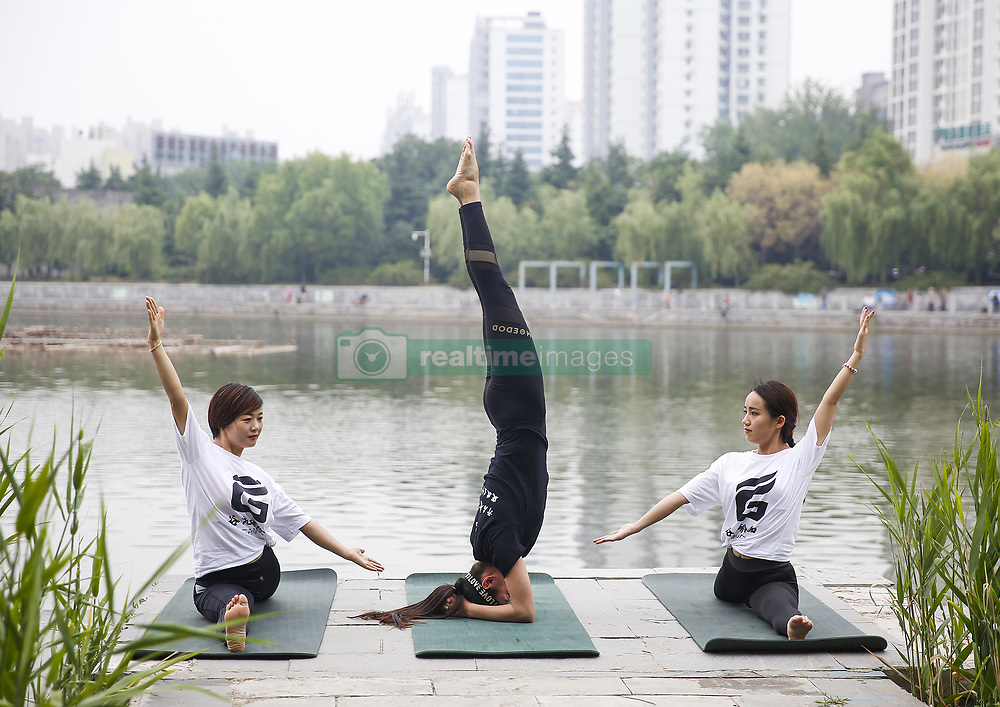 June 18, 2018 - Tengzh, Tengzh, China - Tengzhou, CHINA-18th June 2018: Women practice yoga in Tengzhou, east China's Shandong Province, marking the upcoming International Yoga Day which falls on June 21st every year. (Credit Image: © SIPA Asia via ZUMA Wire)
