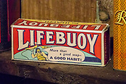 "Lifebuoy box: ""More than a good soap - a good habit!"" The Skye Museum of Island Life preserves a township of thatched cottages as they would have been in the late 1800s on the Isle of Skye, in Kilmuir village, the Trotternish peninsula, Scotland, United Kingdom, Europe. Skye is the largest and northernmost of the major islands in the Inner Hebrides."