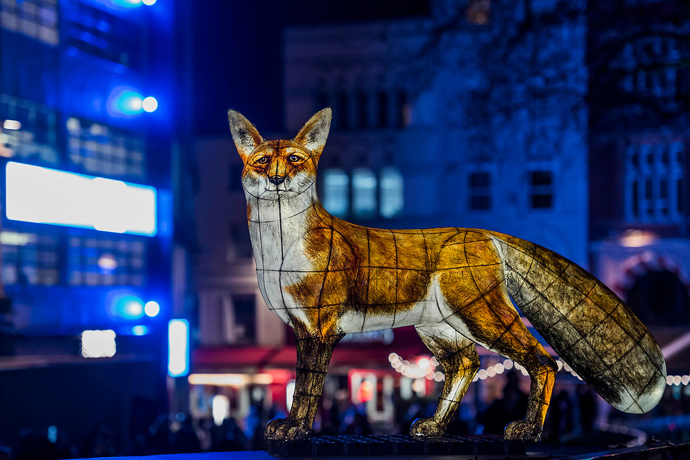 NIGHTLIFE by<br /> Lantern Company<br /> with Jo Pocock in Leicester Square - Lumiere London is a light festival that takes place over four evenings, from Thursday 18 to Sunday 21 January 2018. It showcases the capital's architecture and streets, with more than 50 works created by leading UK and international artists. The free outdoor festival returns to London for the second time following the success of the first edition in January 2016, which attracted an estimated 1.3 million visits. The 2018 edition has an expanded footprint extending north to south, from King's Cross, through Fitzrovia, Mayfair, and London's West End, to Trafalgar Square, Westminster, Victoria, South Bank and Waterloo. Lumiere is produced by Artichoke, the UK's leading producer of outdoor art events.