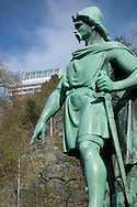 A statue of Rollon the Viking watches over a park in Ålesund, Norway, on May 14, 2013.  The Fjellstua restaurant seen in the distance, at the top of the Aksla lookout. (© 2013 Cindi Christie)