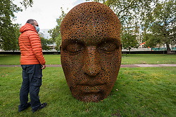 "© Licensed to London News Pictures. 01/10/2020. LONDON, UK. A member of the public views ""Meditation 1554"", 2019, by contemporary Korean artist Seo Young-Deok, on display in Grosvenor Square as part of the inaugural Mayfair Sculpture Trail which will be on show for the month of October.  The sculpture trail forms part of the seventh, annual edition of Mayfair Art Weekend which celebrates the rich cultural heritage of Mayfair as one of the most internationally known, thriving art hubs in the world with free exhibitions, tours, talks and site-specific installations available to the public.  Photo credit: Stephen Chung/LNP"