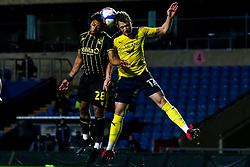 Zain Walker of Bristol Rovers challenges Sam Long of Oxford United to a header - Mandatory by-line: Robbie Stephenson/JMP - 06/10/2020 - FOOTBALL - Kassam Stadium - Oxford, England - Oxford United v Bristol Rovers - Leasing.com Trophy