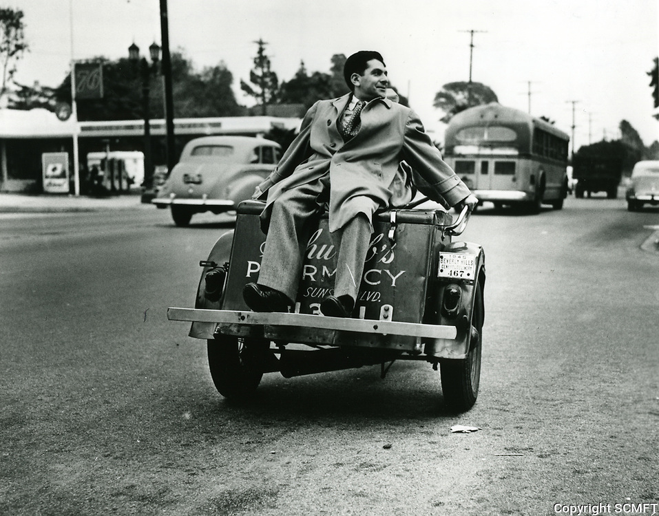 1945 Sidney Skolsky on Schwab's Drugstore delivery motorcycle
