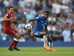 Chelsea's Tiemoue Bakayoko and Liverpool's Trent Alexander-Arnold battle for the ball