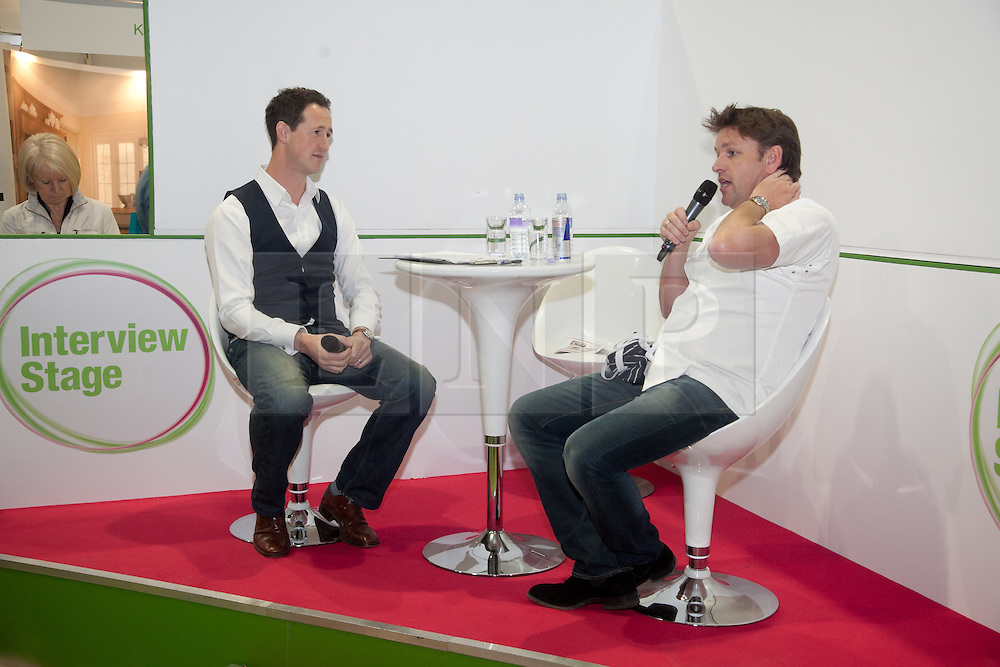 © London News Pictures. 12/04/2012. Gravesend, Kent. Peter Richards Interviewing TV chef James Martin on the interview stage at Glow Bluewater. Opening day of the BBC Good Food Show Spring at Glow, Bluewater, Kent.  Photo credit should read Manu Palomeque/LNP.
