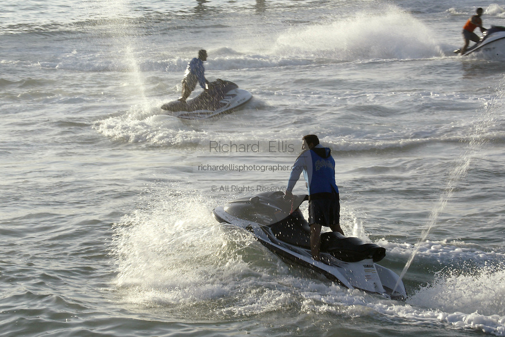 Young wealthy Kuwaitis ride jet skis in the Persian Gulf along the Sharq promanade in Kuwait City.