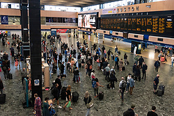 © Licensed to London News Pictures. 27/08/2021. London, UK. Travellers at Euston  Train  Station arrive and depart on the Summer Bank Holiday Weekend. Photo credit: London News Pictures