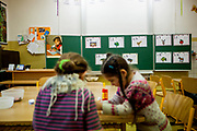 Esther Kroscenova (6) waiting for an enrollment examination (test) and should be a first class pupil in the school year 2016/2017 in a mainstream school in the city of Ostrava, where Roma and non Roma children are educated together. The school is named ZS Chrustova elementary school. The girls are doing some handicraft during waiting for the test. (NO signed MODEL RELEASE for the girl on the left)
