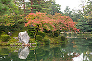 Autumn foliage on Acer trees on Horajima Island in<br />Kasumgaike Pond in the Kenrokuen Garden, Kanazawa, Japan