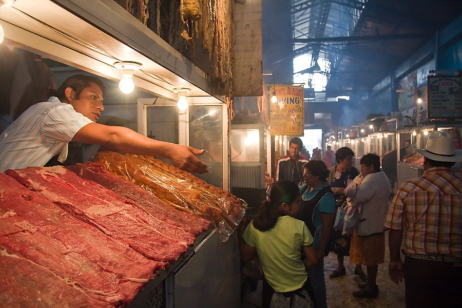 A butcher calls out to shoppers at the meat market in Mercado 20 de Noviembre in Oaxaca City, Oaxaca, Mexico on July 9, 2008.