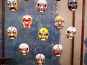 """19 FEBRUARY 2015 - BANGKOK, THAILAND:  Chinese opera masks for sale on Yaowarat Road in Bangkok. 2015 is the Year of Goat in the Chinese zodiac. The Goat is the eighth sign in Chinese astrology and """"8"""" is considered to be a lucky number. It symbolizes wisdom, fortune and prosperity. Ethnic Chinese make up nearly 15% of the Thai population. Chinese New Year (also called Tet or Lunar New Year) is widely celebrated in Thailand, especially in urban areas that have large Chinese populations.   PHOTO BY JACK KURTZ"""