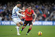 Angel Di Maria of Manchester United holding the ball from Charlie Austin of QPR. Barclays Premier league match, Queens Park Rangers v Manchester Utd at Loftus Road in London on Saturday 17th Jan 2015. pic by John Patrick Fletcher, Andrew Orchard sports photography.
