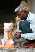 A stone carver at work in the Paharganj area, Jaipur, India