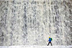 "© Licensed to London News Pictures. 03/02/2021. Derwent UK. Water flows down the face of Derwent Dam in Derbyshire this morning as the recent heavy snow begins to melt. Derwent dam was used by pilots of 617 squadron ""Dam Busters"" to practice low level flying in preparation for Operation Chastise. Photo credit: Andrew McCaren/LNP"