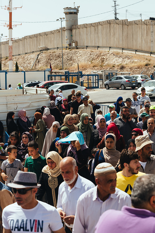 Palestinians cross Qalandiya checkpoint, south of Ramallah, West Bank, on May 17, 2019, on their way to perform the second Friday Prayer of the Muslim holy month of Ramadan, at the Al Aqsa Mosque in Jerusalem. Israeli authorities are introducing biometric border crossing systems at West Bank checkpoints, thus minimizing the interaction between Israeli soldiers and Palestinians crossing into Israel.