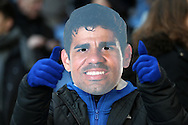 a Chelsea fan wearing a Diego Costa of Chelsea mask celebrates after the Chelsea player scored his sides 1st goal to make it 1-2. Barclays Premier league match, Chelsea v Everton at Stamford Bridge in London on Saturday 16th January 2016.<br /> pic by John Patrick Fletcher, Andrew Orchard sports photography.