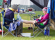 Augusta, New Jersey - Marylou Corino,at right, gets help with her running shoes while taking a break during the 3 Days at the Fair races at Sussex County Fairgrounds on May 11, 2012.