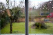 Rain drops on window on wet day