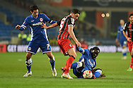 AFC Bournemouth's Tommy Elphick tackles Cardiff's Kenwyne Jones (r).  Skybet football league championship, Cardiff city v AFC Bournemouth at the Cardiff city stadium in Cardiff, South Wales on Tuesday 17th March 2015.<br /> pic by Andrew Orchard, Andrew Orchard sports photography.