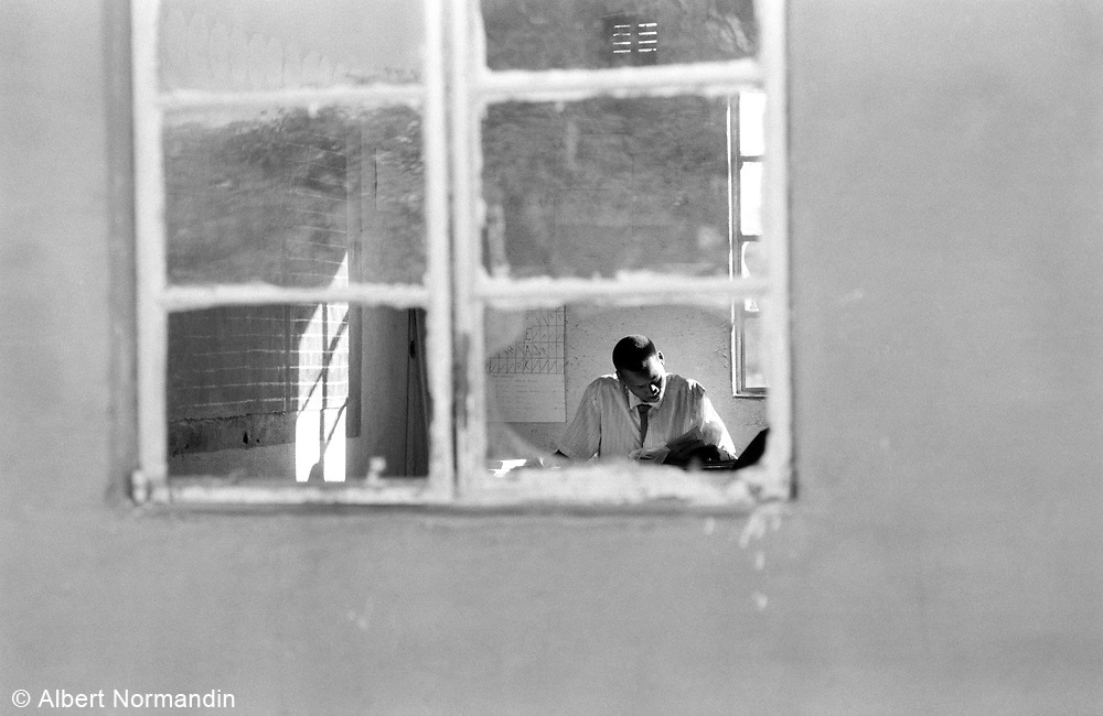 Grade 5 teacher through window, Cherhou School