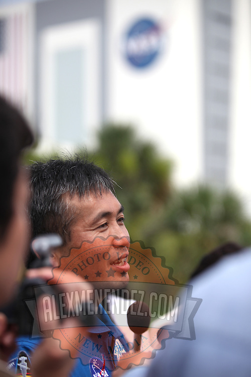 Japanese astronaut Koichi Wakata speaks to the Japanese press after the Space Shuttle Atlantis lifts off from the Kennedy Space Center Friday, July 8, 2011, in Cape Canaveral, Fla. Shuttle Atlantis is the 135th and final space shuttle launch for NASA..  (AP Photo/Alex Menendez)