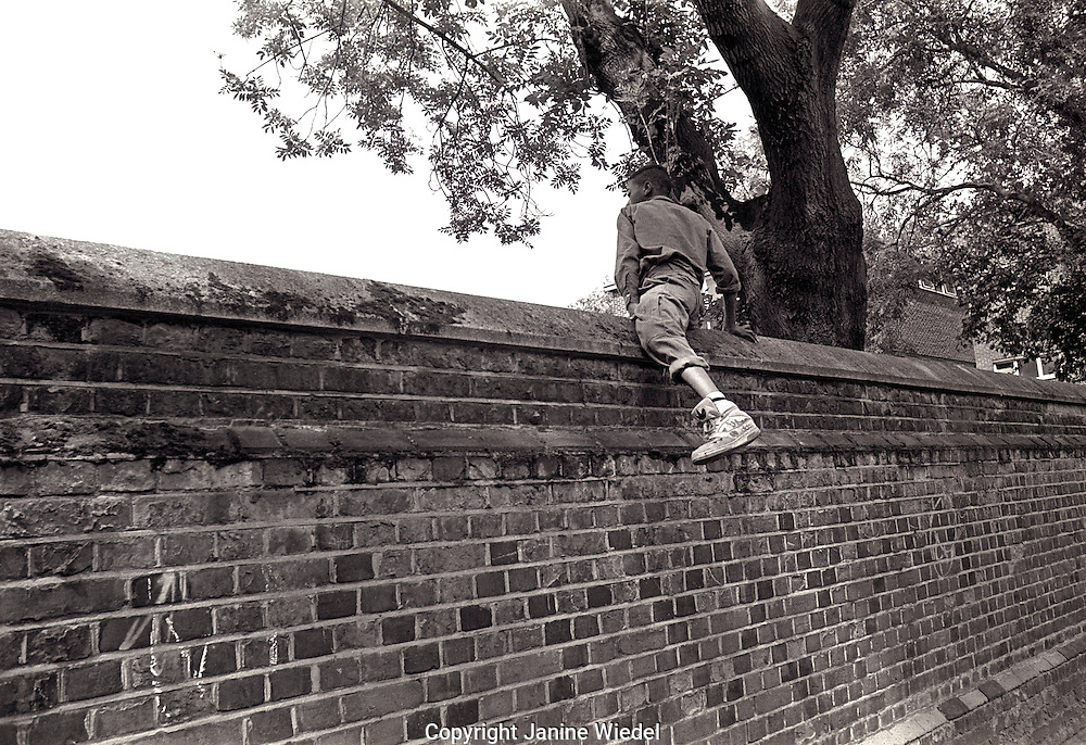 Young lad escaping over the fence.