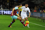 Neil Taylor of Swansea city ® in action. Barclays Premier league match, Swansea city v West Ham Utd at the Liberty Stadium in Swansea, South Wales  on Sunday 20th December 2015.<br /> pic by  Andrew Orchard, Andrew Orchard sports photography.