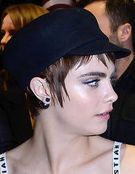Cara Delevingne unveils bizarre ear art in front row as attending the Christian Dior show as part of the Paris Fashion Week in Paris, France on February 27, 2018. The Suicide Squad actress's ear modification is said to be for her role in Amazon's new mythological TV series Carnival Row. Photo by Aurore Marechal/ABACAPRESS.COM