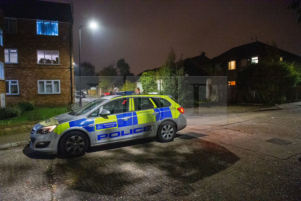 © Licensed to London News Pictures. 31/10/2019. London, UK. A police vehicle at the entrance to Westglade Court, Harrow where police were called at 19:13GMT to reports of a man having been attacked. Metropolitan Police officers attended with London Ambulance Service and found a man, aged in his 30's, suffering from a stab injury to his hand. Another man, also aged in his 30's, was found with a stab injury to his head. Both have been taken to hospital by LAS with non-life-threatening injuries. Photo credit: Peter Manning/LNP