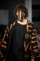 © Licensed to London News Pictures. 03/06/2018. LONDON, UK.  A model presents a look by Zlata Alekhno from Leeds Arts University on the opening day of Graduate Fashion Week taking place at the Old Truman Brewery in East London.  The event presents the graduation show of up and coming fashion designers from UK and international universities.  Photo credit: Stephen Chung/LNP