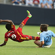 NEW YORK, NEW YORK - June 02: Andrea Pirlo #21 of New York City FC was booked for this foul on Stephen Sunny Sunday #8 of Real Salt Lake during the NYCFC Vs Real Salt Lake regular season MLS game at Yankee Stadium on June 02, 2016 in New York City. (Photo by Tim Clayton/Corbis via Getty Images)