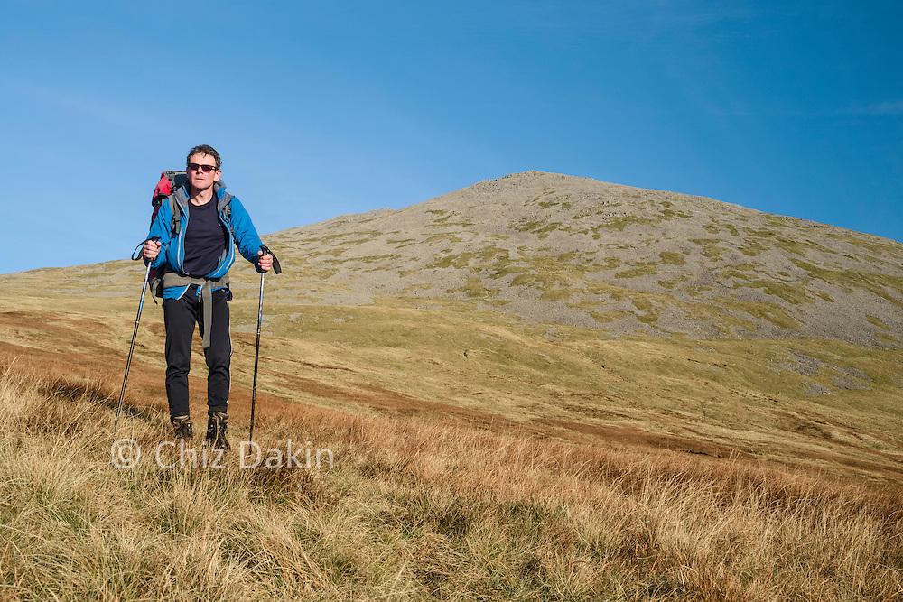 Descending the grassy mid-slopes of Sca Fell