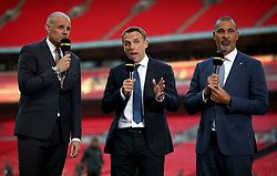 BBC Sport presenters Phil Neville (centre), Ruud Gullit (right) and Jason Mohammad (left) during the Emirates FA Cup Final at Wembley Stadium, London.