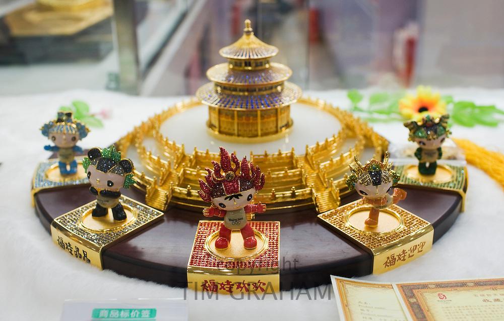 Crystal jewelled 2008 Olympic Games Fuwa mascots plate in souvenir shop, Wangfujing Street, Beijing, China