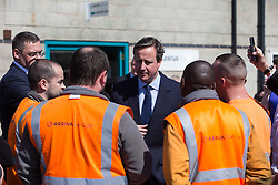 © Licensed to London News Pictures . 20/04/2015 . Crewe , UK . DAVID CAMERON meets staff whilst campaigning outside an Arriva train shed in Crewe , Cheshire as part of the Conservative Party's election run . Photo credit : Joel Goodman/LNP