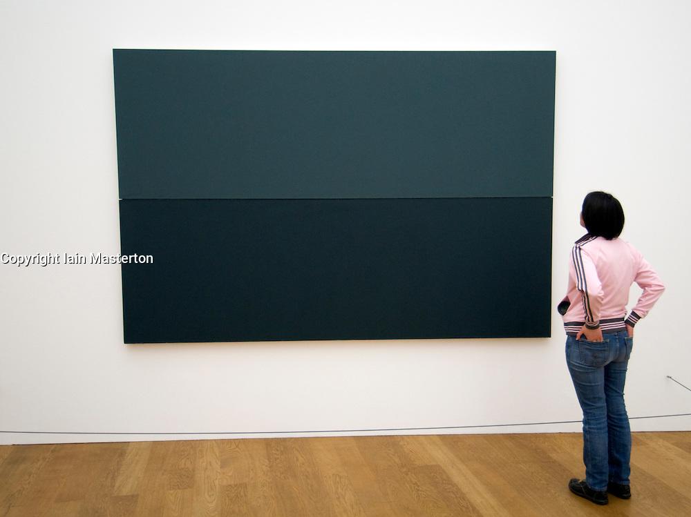 Visitor looking at Modern art painting inside Hamburger Bahnhof Art Gallery in Berlin