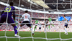 England's Gary Cahill (third right) scores his side's first goal of the game during the International Friendly match at Wembley Stadium, London.