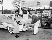 8609-A69.  Transistor Radio Prize Winner. This woman has just won the radio as a prize at Regal Gas, 39th & Powell, Portland, Oregon. February 1957.