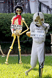30 October 2015. New Orleans, Louisiana.<br /> The Skeleton Krewe mansion on St Charles Avenue at the corner of State Street draws crowds with its satirically spooky Halloween decorations. Elvis Presley is depicted as 'Pelvis Presley.' <br /> Photo©; Charlie Varley/varleypix.com